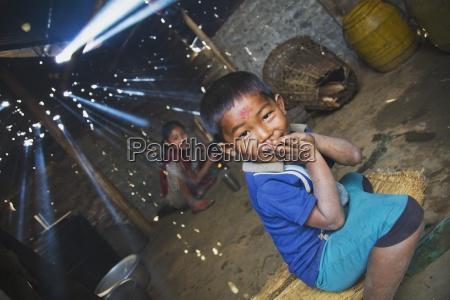 children in smoky cook shack pokhara